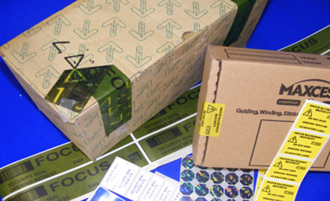 security tape and labels on cardboard boxes
